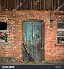 Old Blue Barn Door Broom Windows Stock Photo 299758967 - Shutterstock Barn Door For Bathroom Modern Shower Features Dark Brown Square Door Sliding Glass Blinds As Hdware Ypsilanti Farmers Market Growing Hope With A Blue White Shiplap Walls Frame A Powder On Silver Rail Garage Sale Finds Fridaythe Week I Find Rusty Vintage Stuff 13 Best For Hamptons Images On Pinterest Salina Ks Ideas Unusual Design Come With Color Painted Slidgbndoorcabinetarwprojectstep12 Arrow Fastener Shed