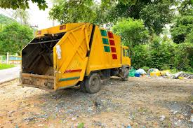 Yellow Rubbish Truck Stock Photo, Picture And Royalty Free Image ...