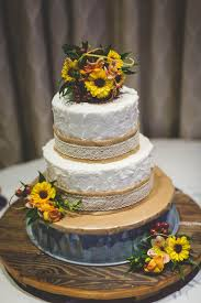 This Two Tiered Cake Featured Sunflowers And A Burlap Lace Trim Event Planner