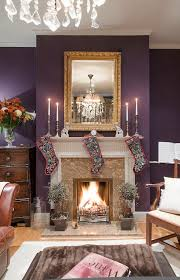 a cozy christmas living room the purple walls are nice my
