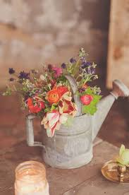 Old Watering Can Used As A Vase Wedding Decoration Idea