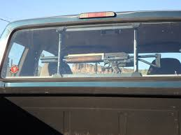 POTD: Weird Franken-Gun In Pickup Truck Gun Rack -The Firearm Blog