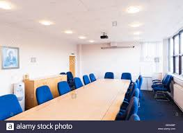 Ceiling Mount For Projector Screen by A Typical Boardroom Meeting Room Conference Room Featuring A