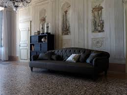 Blacl Leather Chesterfield Sectional With Cushions And Shabby Chic White Painted Wall Panel