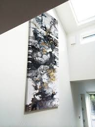 A Large Black And White Abstract Painting With Gold Cream Accents