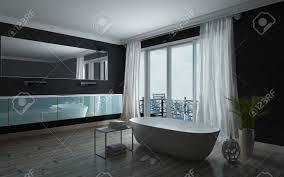 stilvolle schwarze und weiße badezimmer interieur mit einer freistehenden badewanne vor großen fenstern auf einen balkon mit langen wand führenden