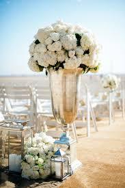 Beach Wedding With Chrome Oversized Lantern At Aisle Entrance