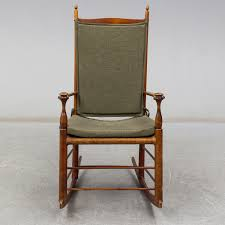 An Early 20th Century Rocking Chair. - Bukowskis Champlain Patio Rocking Chair Acacia Wood Cushioned Traditional Midcentury Modern Teak Finish With Yellow Cushions An American Adirondack Rocking Chair Early 20th Century Sold A Sam Maloof Double Fetched 35000 Century Antique Better Homes Gardens Ridgely Slat Back Mahogany Retro Voorhees Craftsman Mission Oak Fniture Gustav North Wind Carved Signed 1900s Rocker Foa Skull For My Husband As An Early Fathers Late 19th Leather Personalised Wooden Teyboutiquecom