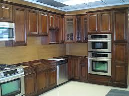 Kitchen Backsplash Ideas With Dark Oak Cabinets by Kitchen Brown Wooden Cabinet Island White Countertop Kitchen