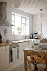 Farmhouse Kitchen Design With Beadboard Ceiling Punctuated White Glass Globe Flushmount Lighting As Well Off Cabinets Paired Butcher Block
