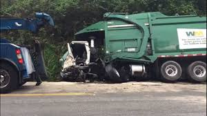 100 Waste Management Garbage Truck Truck Driver Rescued After Crash With Pickup KIROTV