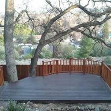 trex deck built on a very steep hill with custom redwood handrail