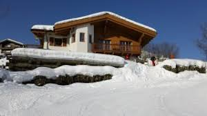 chalet on the slope for ski in ski out slopeside winter sports