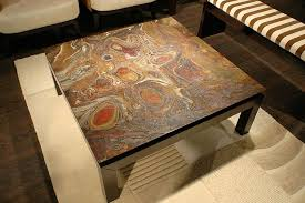 coral coffee table in clear glass top granite coffee table