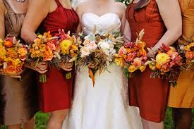 Bridesmaids In Multiple Shades Of Red Gold And Brown For A Fall Wedding