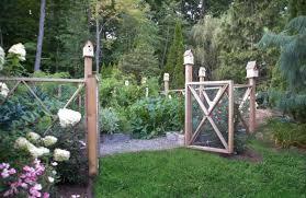 Decorative Garden Fence Border by A Cedar Decorative Fence And Birdhouses Surround An Organic