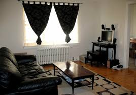 Brown Leather Sofa Decorating Living Room Ideas by Black Leather Sofa With Rectangular Brown Polished Wooden Table