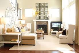 Living Room Stunning Home Decor With Corner Brick Fireplace And L Shape Cream Sofa Also Frame Wall Art Plus Round Clock Warm Ambiance