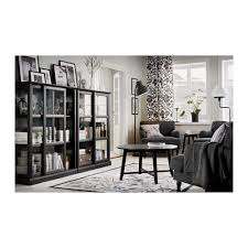 Small Living Room Ideas Ikea by In A Dining Room A Glass Door Cabinet Holds Glasses Plates And