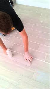 porcelain wood look tile grout dried to light