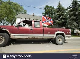 Whitmore Lake, MI, USA. 18th July, 2015. A Truck Drives Down Main ... Confederate Flag Truck Seat Covers Velcromag Columbia Spy A Case Of Mistaken Identity Rebel Edition Ford F150 Youtube Flags Flying At School Causing Stir Accsories Bozbuz In Canton Parade Spark Outrage Wlos Flags Pop Up At Christmas Parade Bpr Cop Flies Antitrump Protest Texans Are Very Upset That This Food Wants To Burn Fans Face Gang Charge For Crashing Black Kids Party Someone Should Explain This Me There Were About A Dozen Trucks Flag Ehs Concerns Upsets Community The Ellsworth