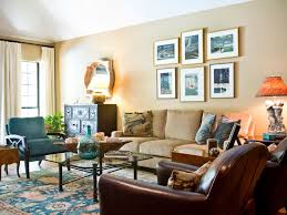 Eclectic Living Room With Gallery Wall And Oriental Rug A Sextet Of Framed Nautical Scenes Hang In This Which Includes Elements Traditional