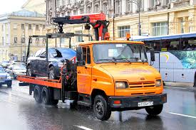 A Flatbed Tow Truck Carrying Car