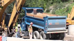 100 Blue Dump Truck Kenworth Dumping Dirt On A Road Construction Site