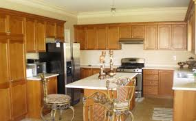 kitchen wall paint plus light brown wooden cabinet with