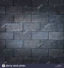 Concrete Block Wall Or Weathered Cinder Background With A Blank Rough Rustic Cement Surface Texture As Backdrop
