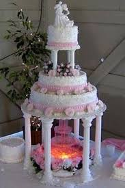 old fashioned tier and fountain and stairs wedding cakes pictures