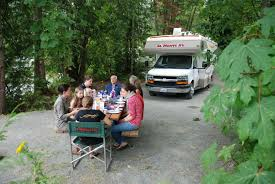 Picture Of An RV Camping Picnic In The Woods