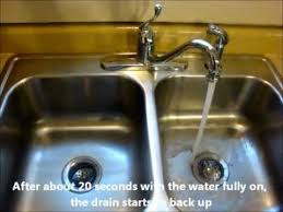 Unclogging Kitchen Sink Pipes by Slow Kitchen Sink Drain Clogged Drain How To Unclog A Clogged