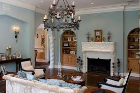 Vintage Chandelier Inside Family Area With Teak Table And Comfy Sofa Using Mediterranean Living Room Ideas