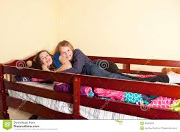 two teens in bed stock photo image 49348204