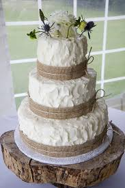 Rustic Wedding Cake And Wooden Tree Stand Decorated With Burlap Ribbon Twine
