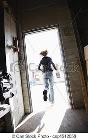 Woman running out door Woman running through open door from