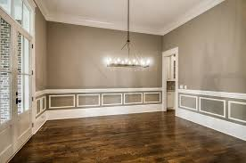 View Full Size Amazing Dining Room Features Walls Painted Gray Accented With White Wainscoting And Chair Rail Alongside Glass