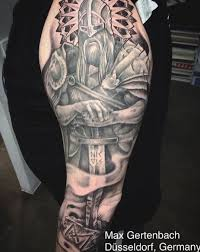 A Norse Mythology Tattoo Design Would Look Incomplete Without Warrior In It Also You Have To Show The Full AttireTraditional Viking Tattoos