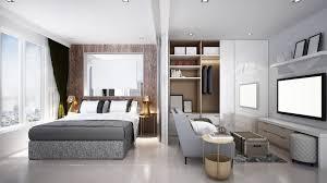 schlaf und wohnzimmer in einem kleinen raum betten abc