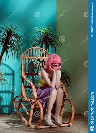 Beautiful Stylish Bored Girl In Pink Wig Sitting In Rocking ... Happy Calm African Girl Resting Dreaming Sit In Comfortable Rocking Senior Man Sitting Chair Homely Wooden Cartoon Fniture John F Kennedy Sitting In Rocking Chair Salt And Pepper Woman Sitting Rocking Chair Reading Book Stock Photo Grandmother Her Grandchildren Pensive Lady Image Free Trial Bigstock Photos Hattie Fels Owen A Wicker Emmet Pregnant Young Using Mobile Library Of Rocker Free Stock Png Files