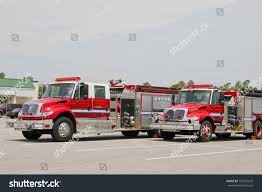 2 Red Fire Trucks Parked Large Stock Photo (Safe To Use) 757491619 ... Dz License For Refighters Amazoncom Kid Trax Red Fire Engine Electric Rideon Toys Games Normal Council Mulls Lawsuit Over Trucks Wglt Municipalities Face Growing Sticker Shock When Replacing Fire Trucks File1958 Fwd Engine North Sea Fdjpg Wikimedia Commons Tonka Truck 9 Listings Why Are Firetrucks Frame Holds 4 Photos Baby No Seriously Are Vice Matchbox 10