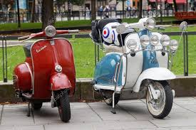 Two Beautiful Red And Blue White Retro Vespa Scooters Parked Stock Photo 122289576