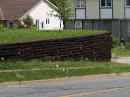 How To Build Retaining Walls With Railroad Ties - Incoming ... Brick Garden Wall Designs Short Retaing Ideas Landscape For Download Backyard Design Do You Need A Building Timber Howtos Diy Question About Relandscaping My Backyard Building Retaing Fire Pit On Hillside With Walls Above And Below 25 Trending Rock Wall Ideas Pinterest Natural Cheap Landscaping A Modular Block Rhapes Sloping Also Back Palm Trees Grow Easily In Out Sunny Tiered Projects Yard Landscaping Sloped
