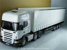 SCANIA ARTICULATED CURTAINSIDE TRUCK & TRAILER 1:50 MODEL CARARAMA ... Different Models Of Trucks Are Standing Next To Each Other In Pa Old Mercedes Truck Stock Photos Images Modern Various Colors And Involved For The Intertional 9400i 3d Model Realtime World Sa Ho 187 Scale Toy Store Facebook 933 New Pickup Are Coming 135 Tamiya German 3 Ton 4x2 Cargo Kit 35291 124 720 Datsun Custom 82 Kent Mammoet Dakar Truck 2015 Wsi Collectors Manufacturer Replica Home Diecast Road Champs 1956 Ford F100 Australian Plastic Italeri Shopcarson