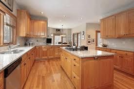 light brown kitchen cupboards black coffee maker mahogany wood