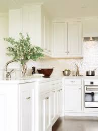 of pearl backsplash tile kitchen traditional with light