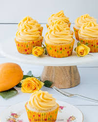 Mango Cupcakes On A Marble Cake Stand With Yellow Roses