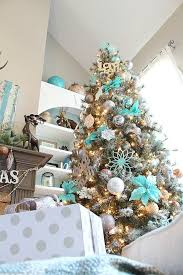 Copper Silver And Grays Really Make The Turquoise Pop On This Snowy Christmas Tree