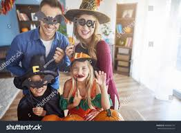 Funny Halloween Half Masks by Family Wearing Funny Halloween Masks Stock Photo 486059770